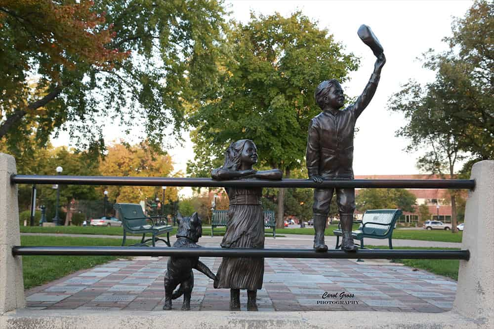 A Simpler Time   Photo of bronze sculpture of two children and a dog